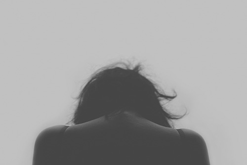 Woman grieving, monochrome
